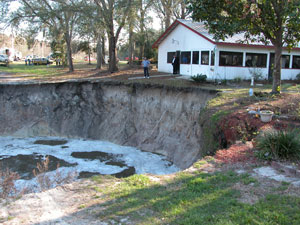 Large Sinkhole Near a Home Opens in new window