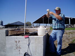 Technician Sampling Wastewater